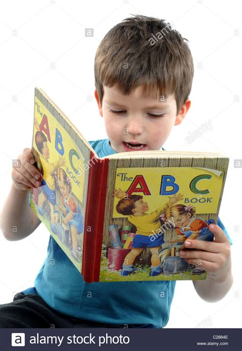 picture of child reading book boy reading a book child reading stock photo royalty