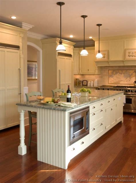 kitchen island with cabinets and seating pictures of kitchens traditional off white antique