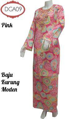 two wearing baju kurung national dress of