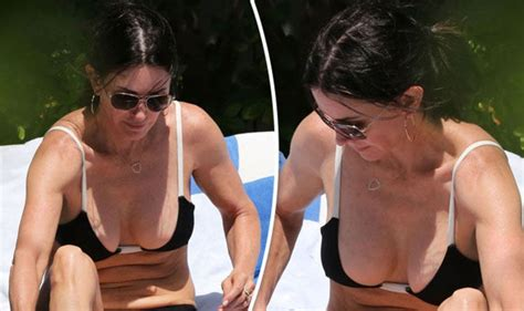who does lucy davis look like courteney cox flashes major cleavage in sexy swimwear
