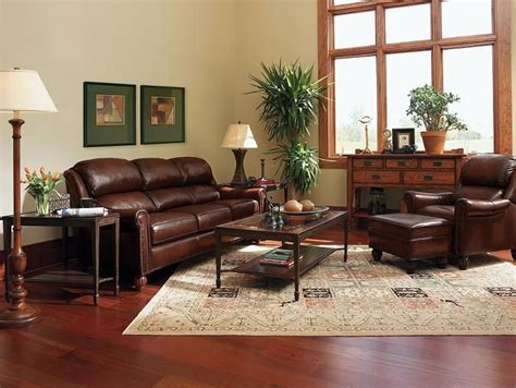 Living Room With Burgundy Sofa by Brown Decorating Ideas The Living Room With
