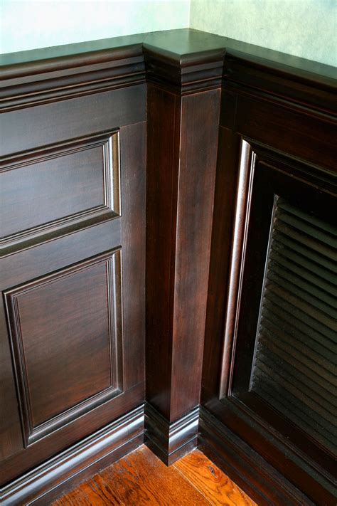 Wainscoting Corners by A Formal Dining Room In Walnut