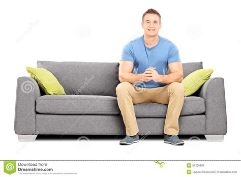 Sofa Sitting by Handsome Sitting On A Modern Sofa Stock Photo