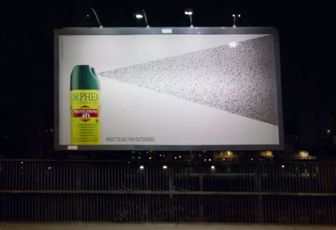 clever marketing billboard turned  insect trap  bug spray ad