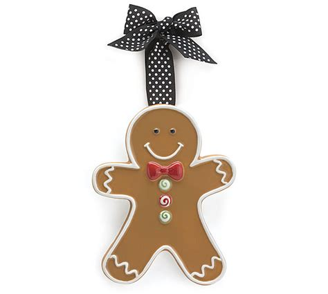 gingerbread ornament out of brown paper brown gingerman shaped ceramic adornment