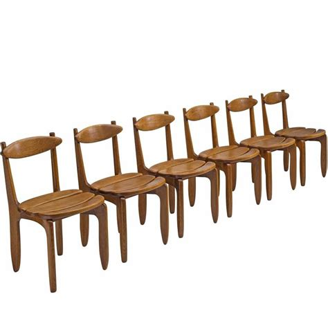 Solid Oak Dining Chairs For Sale Set Of Six Patinated Solid Oak Guillerme And Chambron Dining Chairs For Sale At 1stdibs