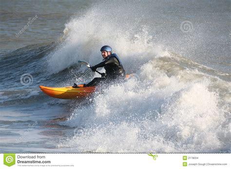 canoes surf break kayak sea wave surfing stock images image 2178034