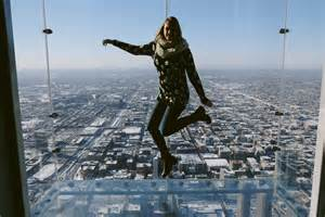 willis tower deck skydeck chicago chicago illinois jumping above chicago