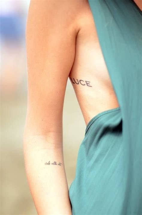tattoo placement and what it means script small tattoos ribs and arm i like the arm