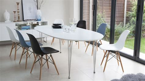 White Oval Dining Table And Chairs Ellie Oval Extending And Eames Style Dining Set