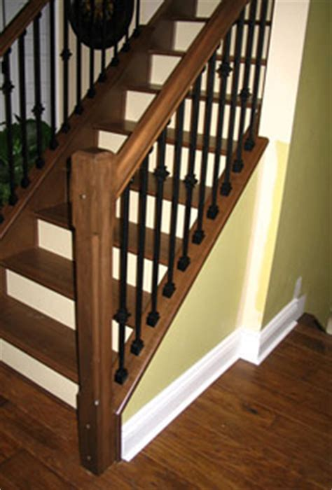 dark wood banister maple newel posts and handrail black metal spindles sudbury ontario basement ideas