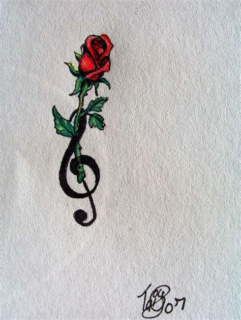 rose and music tattoo and i one on my hip almost