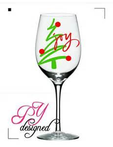 christmas wine glass with christmas tree and joy