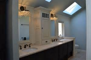 tower in center of bath vanity cabinetry 2 tone