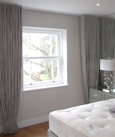 drapes on ceiling ceiling to floor wall to wall curtains guest bedroom