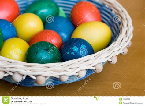 wicker basket with handmade coloured easter eggs royalty