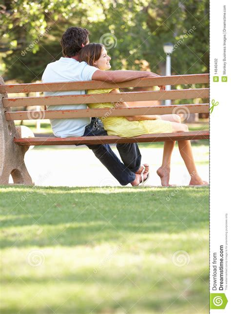 sitting in a park bench couple sitting together on park bench male models picture