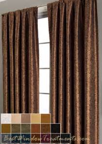 copper colored curtains against the light blue wall