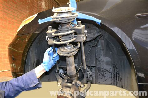 how to replace strut with spring in a place on a 2008 volkswagen eos bmw 5 series 530i e60 2003 2010 replacing the front shocks pelican parts technical article