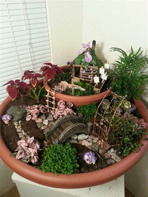 Cool Planters by 13 Tips To Create A Fairy Garden Your Kids Will Love