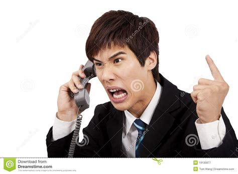 Screaming Phone angry businessman screaming on the phone royalty free