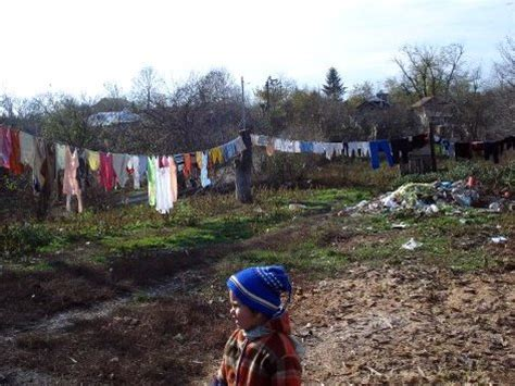 child poverty in romania | a child plays in a desperately