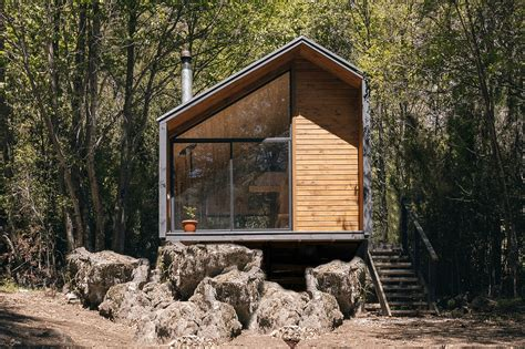 minimalist cabin in the chilean mountains lets climbers