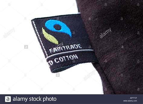 7 Fairtrade Garments by Fair Trade Clothing Logo On A Black T Shirt Stock Photo