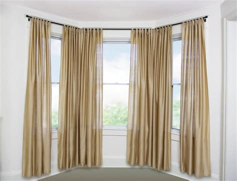 curtains on bay window best curtain rods for bay windows homesfeed
