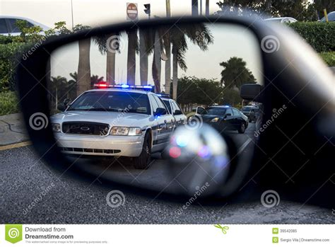 cop lights in mirror on rear view mirror stock image image of pursuit