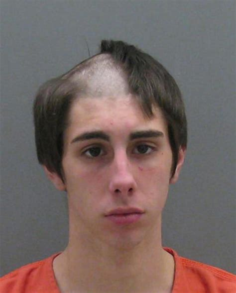 see it mich man arrested as he shaved his head as