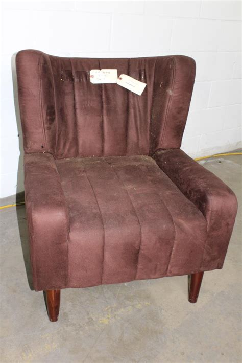 brown fabric armchair brown fabric arm chair property room