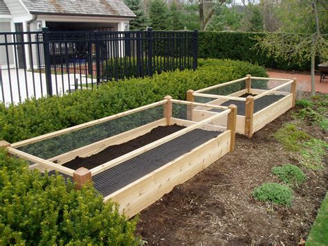 raised garden bed with fence two raised garden beds with rabbit railing 3x8x2
