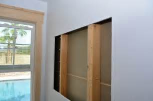 built in the wall shelving reclaiming hidden storage comment habiller un angle dans une pi 232 ce cocon de