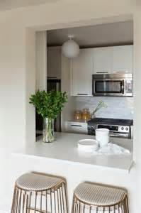 Kitchen Pass Through Design Pictures chic kitchen boasts white cabinets paired with white quartz