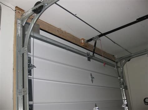 On Track Overhead Doors Garage Garage Door Track Ideas Garage Door Tracks Garage Door Tracks Garage Door Track