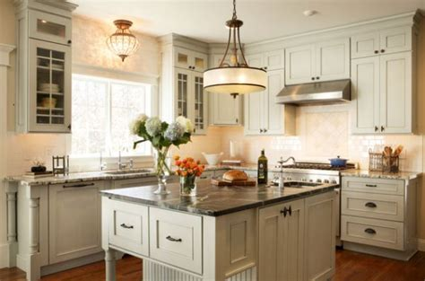 awesome Single Pendant Lighting Over Kitchen Island #1: Large-single-pendant-light-above-a-small-kitchen-counter-looks-like-a-modern-chandelier.jpg