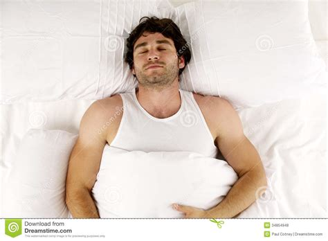 man laid in white bed sleeping royalty free stock photos