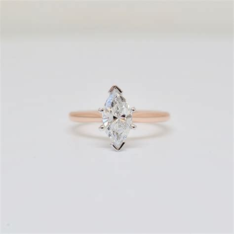 marquise brilliant in a six prong solitaire engagement