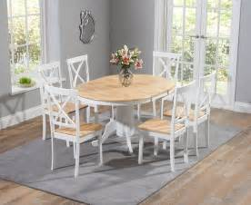 oak and white kitchen table buy the epsom oak and white pedestal extending dining table set with chairs at oak furniture