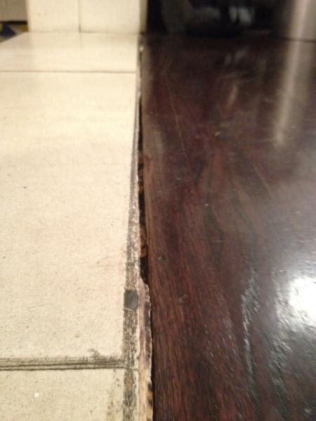 Wood Floor Into Stone transition   DoItYourself.com