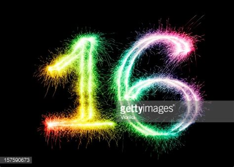 sparkling number 16 on a black background stock photo