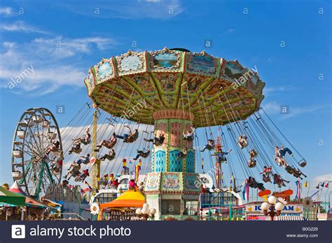 carnival swing ride carnival swing ride with kids and families having fun