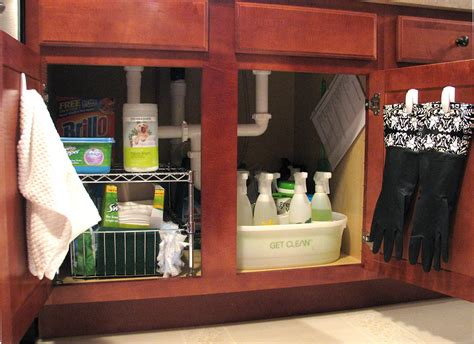 great idea for supplies under the kitchen sink too organizing under the sink living rich on lessliving rich