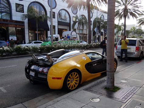 custom bugatti custom yellow black bugatti veyron spotted in beverly