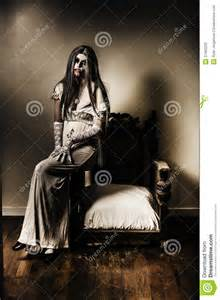 Vintage Sitting Room - evil vampire woman in old grunge haunted house stock photos image 37462203