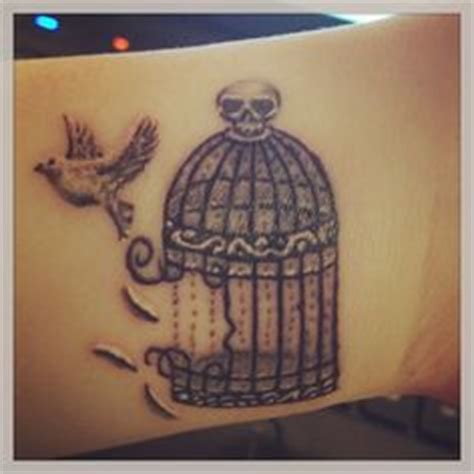 break free tattoo broken bird cage