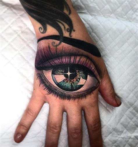 eye on girls hand best tattoo design ideas