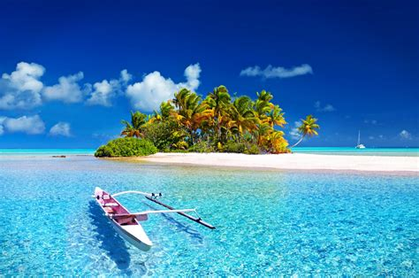 beautiful island   sandy beach  boat blue water