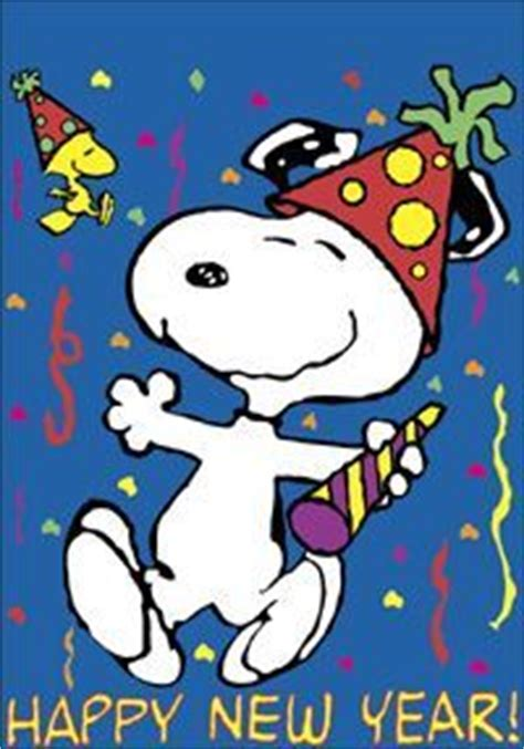 celebrating snoopy snoopy celebrating the new year pictures photos and